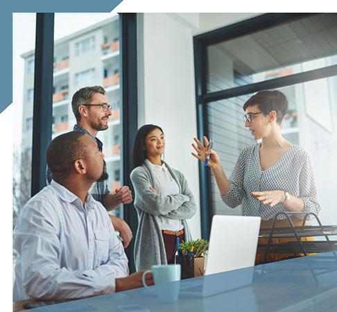 Colleagues meeting, focused on woman talking