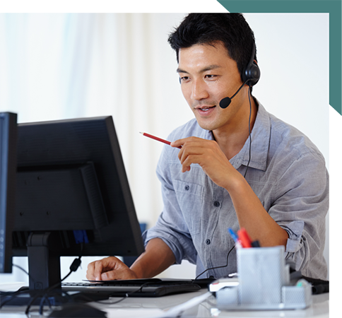Man in headset in front of computer